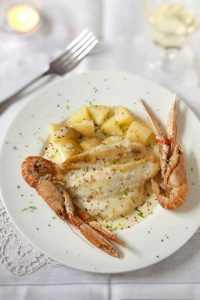 Recette Filets de soles crémés au citron sur lit de pommes de terre et langoustines