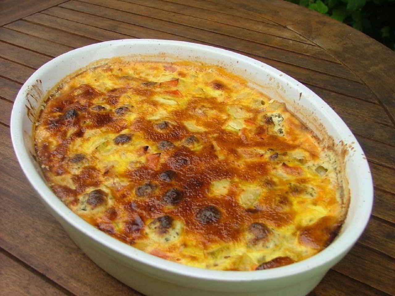 Recette Clafoutis aux tomates, courgettes et boursin
